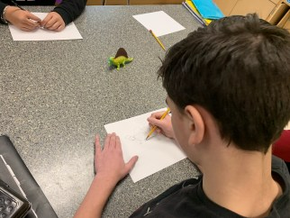 A student draws from observation after learning how to break down complex images and 3D forms into simple 2D shapes.