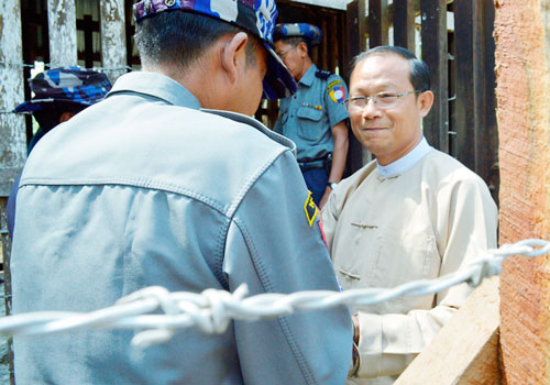 Writer and National League for Democracy information officer Htin Linn Oo (right) arrives at Chaung Oo Township Court in Sagaing Region on March 24. (Than Naing Soe/The Myanmar Times)
