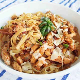 The Love Machine Chicken Pasta. Chicken sauteed in butter and garlic and rich sundried tomato cream sauce. Topped with freshly grated parmesan cheese and basil.