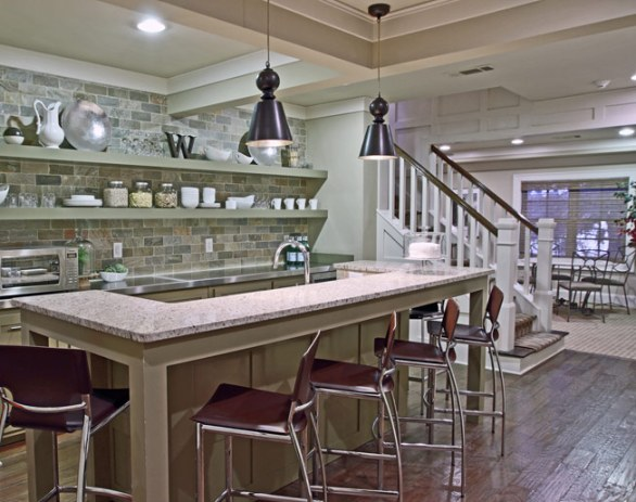 Kitchen with island and staircase.