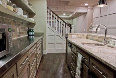 Kitchen with stairway.