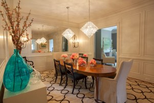 Dining room with large mirror.
