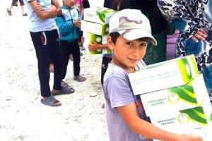 الحملة الوطنية السعودية توزع المواد الإغاثية على 565 أسرة سورية في إربد