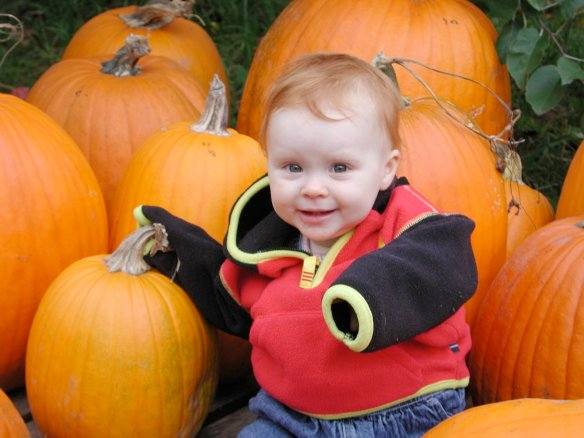 The first pumpkin patch with the solo child.