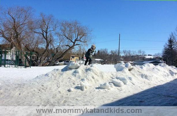boy playing in snow saskatchewan
