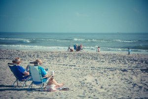 An old couple relaxing on the beach 2