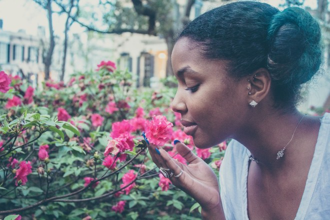 african-american-woman-smelling-flower-photo-1428624485403-3af063604a7a