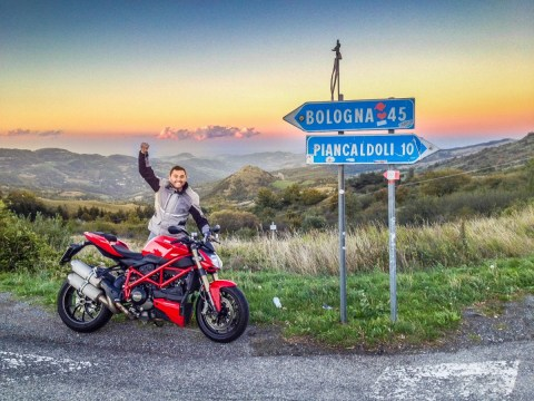 Nik celebrates the top of the Futa Pass! Wow, what a view, ride, experience!