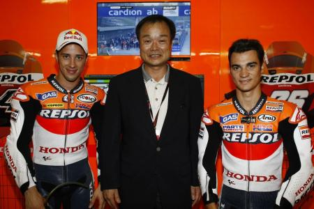Andrea Dovizioso (left) has earned a factory ride next season. Hopefully Honda President and CEO Takanobu Ito can help him sort that out.