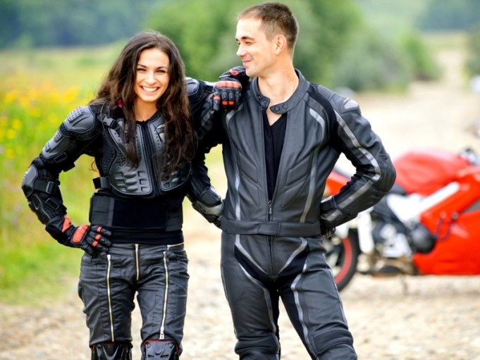 two young people against motorbike