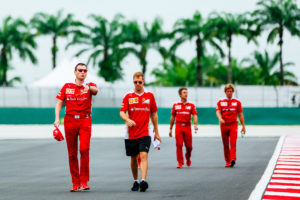 sebastian_vettel_and_his_team_walk_the_sepang_circuit
