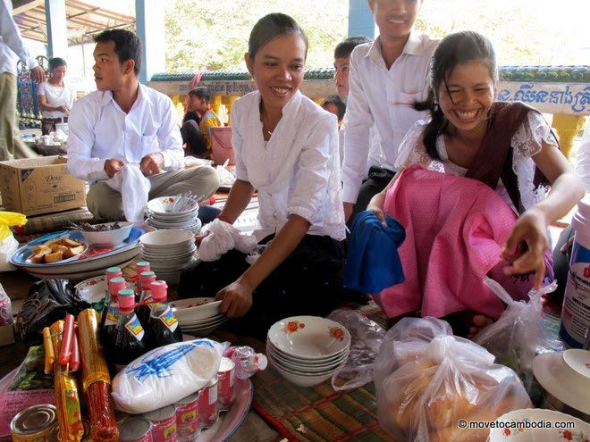 Girls laughing and smiling during Pchum Ben