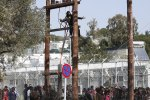 A Pakistani migrant climbs a utility pole during a demonstration inside the Moria registration centre on the Greek island of Lesbos, April 6, 2016. REUTERS/Giorgos Moutafis