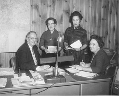 1952 - Herb DeRoth, Treasurer on left reviewing accounts receivable aging with accounting staff.