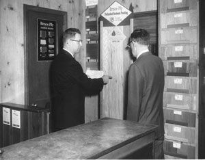 1963 - Robert A. Boyd, Jr. & Roy McLean, Sales Manager reviewing Bruce Flooring samples.