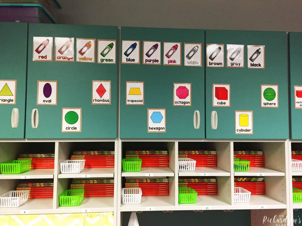 This teacher uses her storage cabinets to display her color posters and shape posters. She also stores student books in their cubbies, along with little baskets to hold ear buds.