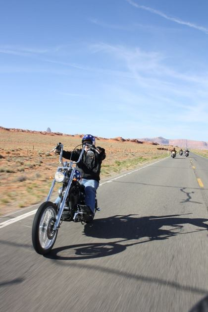 Captain America bike riding through Monument Valley