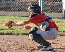 Post 119 catcher.  Democrat photo by Pat Dollins
