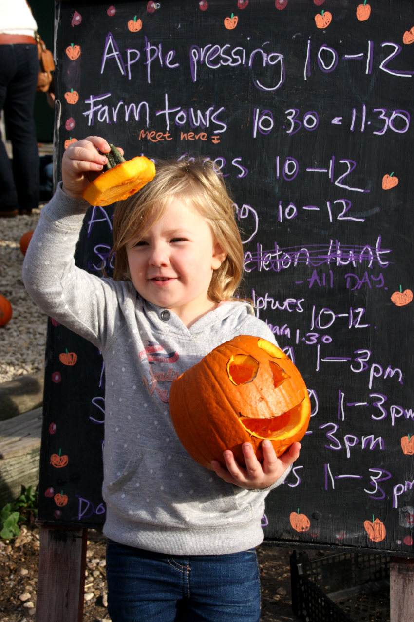 Amy showing off her carved pumpkin