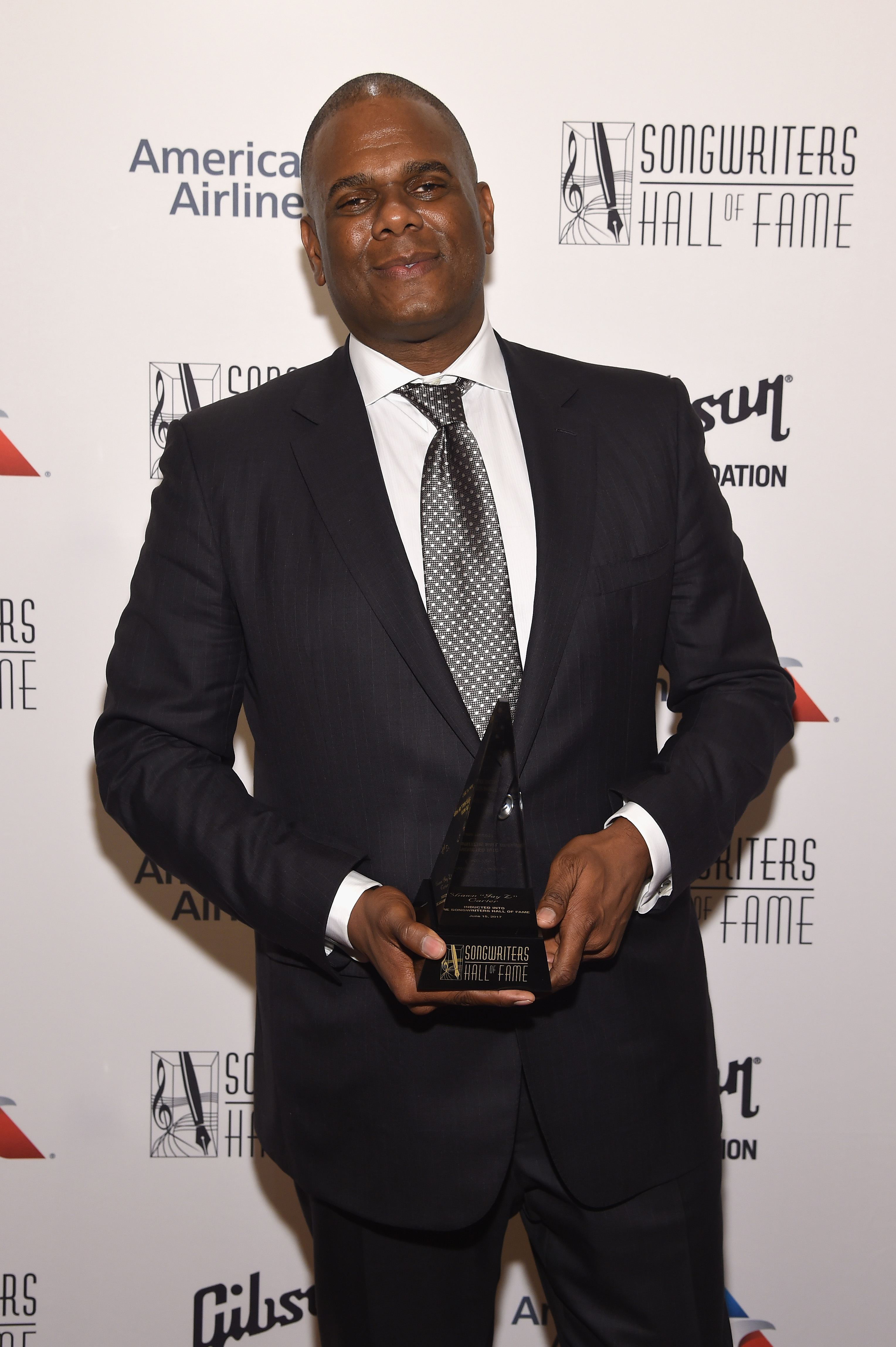 "NEW YORK, NY - JUNE 15:  Warner/Chappell Music CEO Jon Platt poses backstage after accepting Shawn ""Jay Z"" Carter's award at the Songwriters Hall Of Fame 48th Annual Induction and Awards at New York Marriott Marquis Hotel on June 15, 2017 in New York City.  (Photo by Larry Busacca/Getty Images for Songwriters Hall Of Fame) *** Local Caption *** Jon Platt"