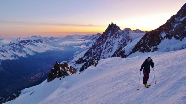 Gabby skinning up Mont Blanc with Aiguille du Midi in the background. Photo - Calum Muskett