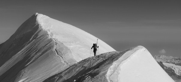 Ally Swinton heading along the ridge from the summit of Castor in the Pennine Alps. Photo - Calum Muskett