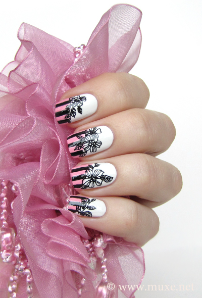 Black flowers and stripes nail design