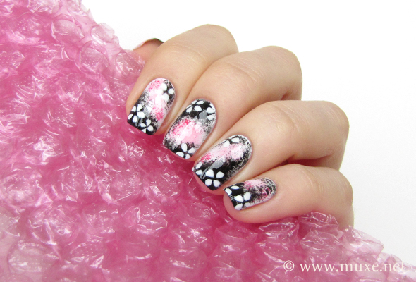 Sakura nail design in pink and black