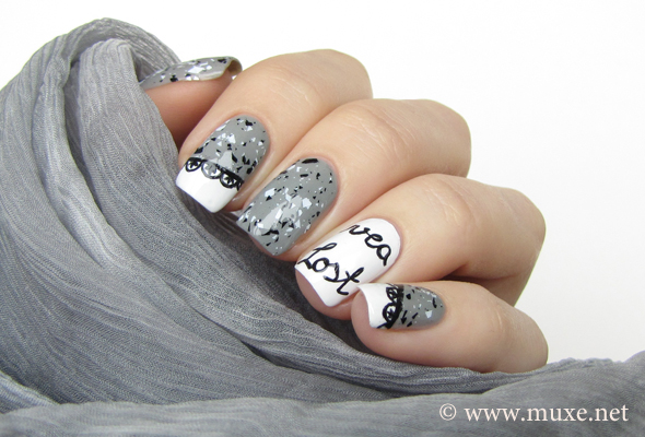 Nail art design with text and letters