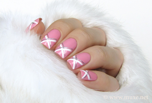 Pink nails with white nail art