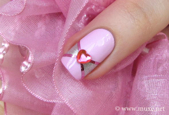Pink nails with hearts and rhinestones