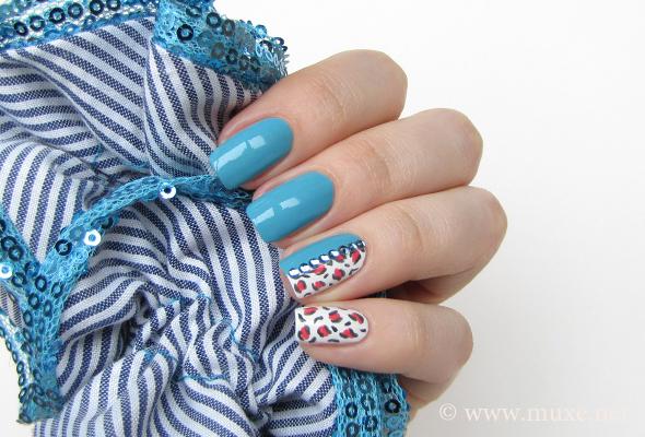 Leopard print nail art on blue