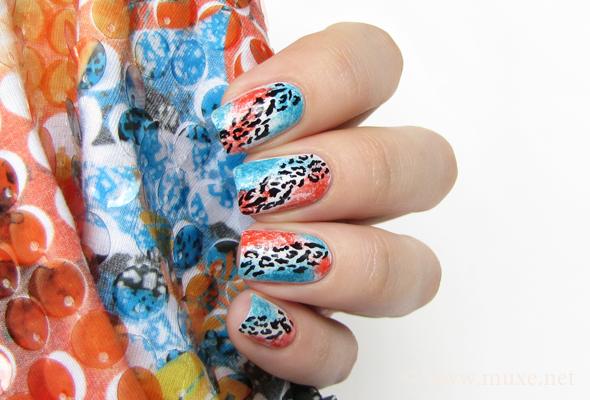 Leopard nails in blue and orange design