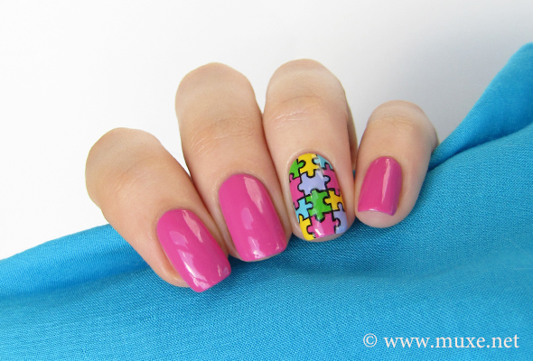 Bright puzzle nail art in pink