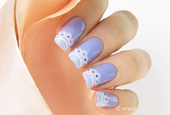 Lilac nails with white laces