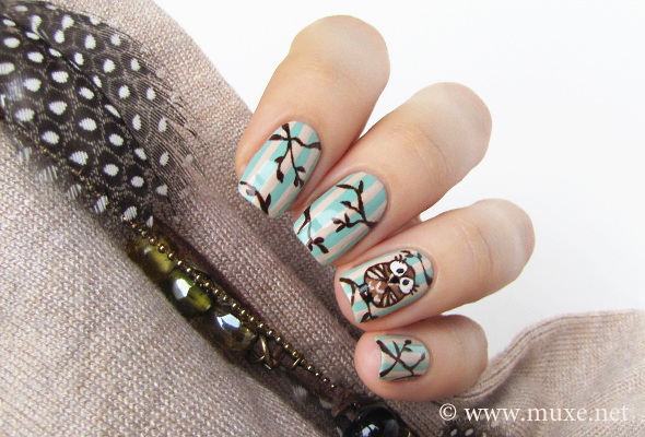 Nails with an owl and branches