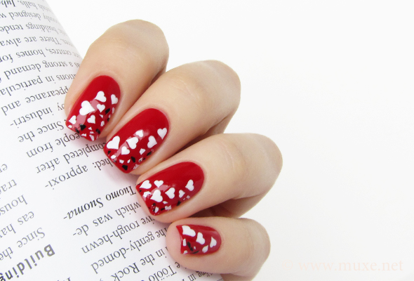 Valentine's Day red nail art with hearts