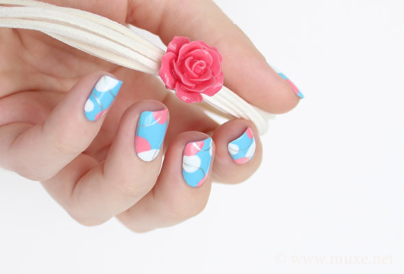 Light blue nail art with circles