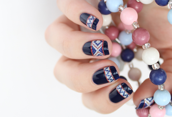 Dark blue nail design with white and red