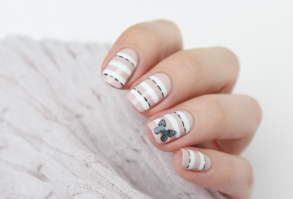 Nude nail design with white stripes