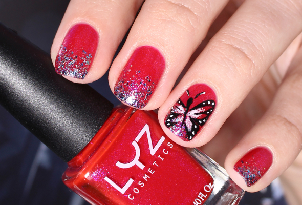 Butterfly nail art on red