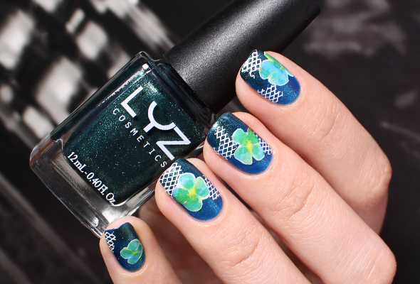 Floral nail design over blue and green