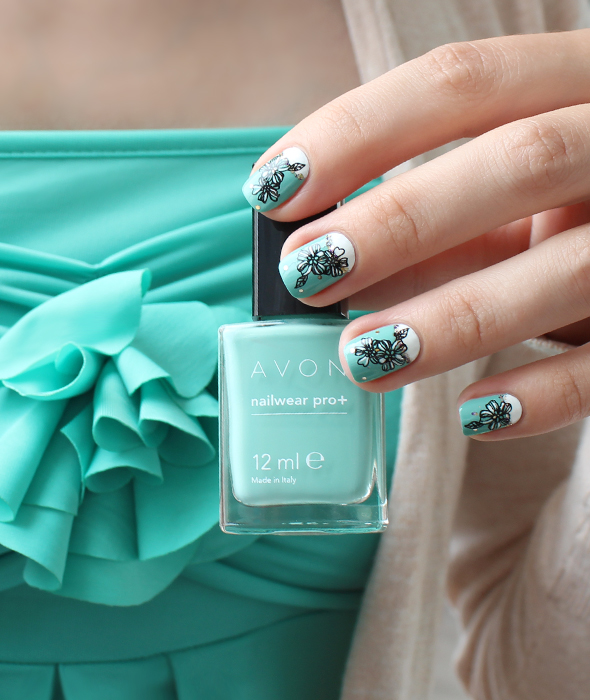 White and mint half moon nails design with flowers