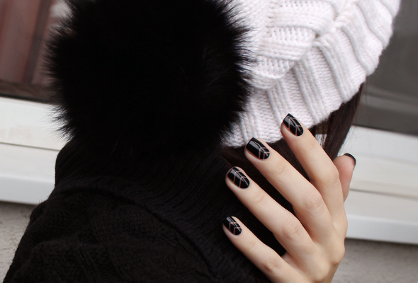 White knitted hat with black pom pom