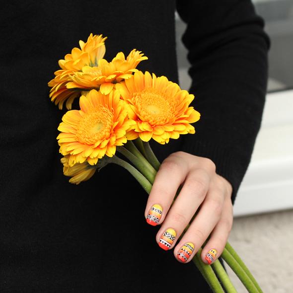 Yellow and orange tribal nails design