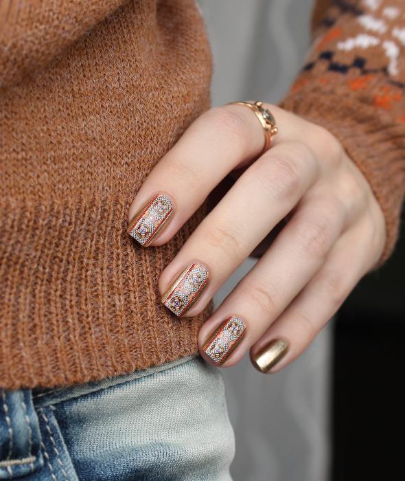 Gold brown nail design