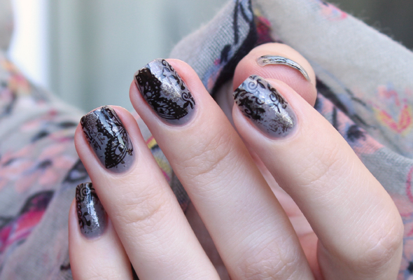 Black butterfly and lace nail design