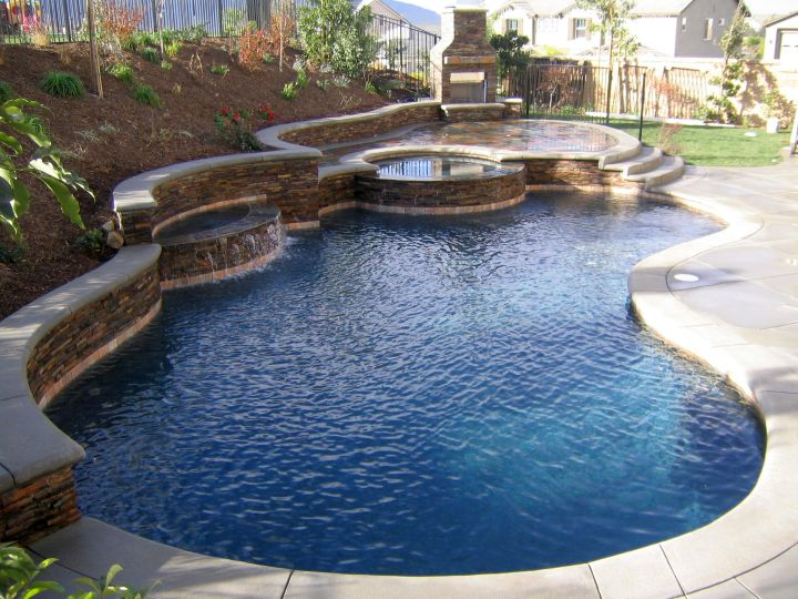 17 refreshing ideas of small backyard pool design for Swimming pool landscape design ideas
