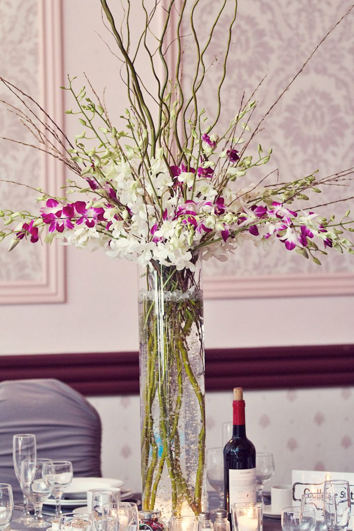 Tall vase with branches for wedding center piece