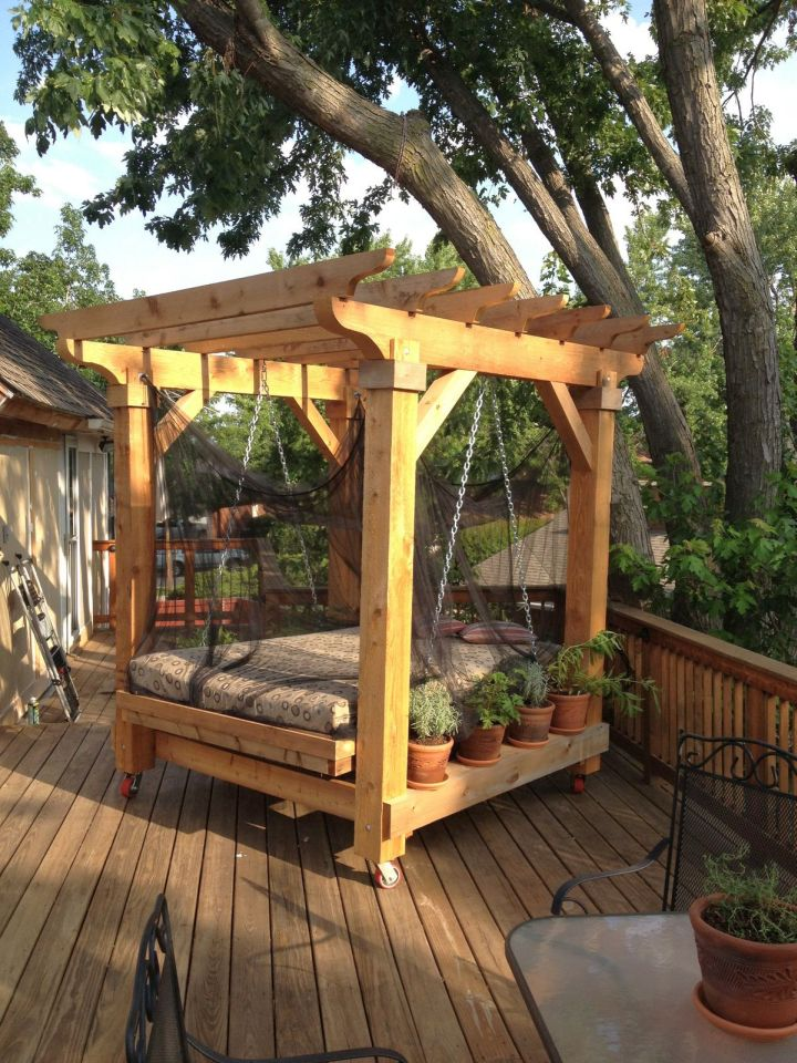 18 restful outdoor swinging bed designs